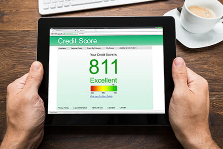 a person checks their credit score on a tablet